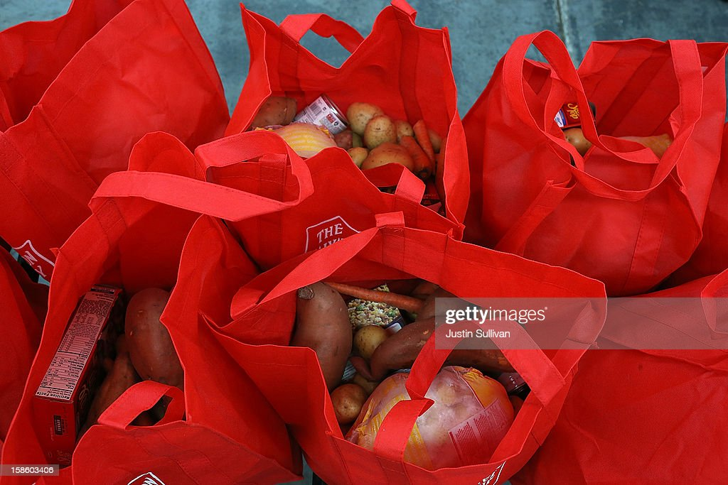 Bags filled with food wait to be picked up during the Salvation Army's Toy & Joy Shop Distribution on December 20, 2012 in San Francisco, California. With less than one week before Christmas, the Salvation Army's Golden State division held a Toy & Joy Shop Distribution event that allows families in need to shop for free toys and receive a bag with ingredients to make a holiday meal. Nearly 1,500 families will attend the two day event.