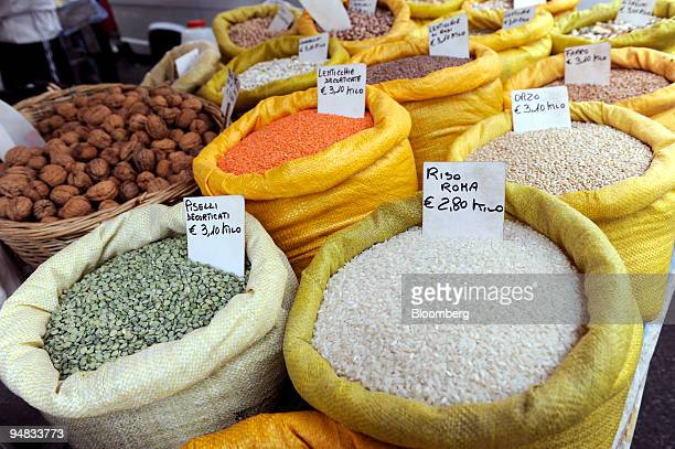 Bags filled with rice and legumes sit at an outdoor market in Milan Italy on Monday May 19 2008 The European Central Bank has refrained from...