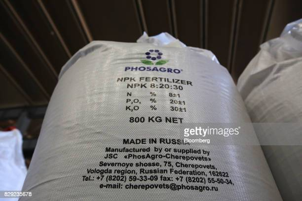 Bags of Ammophos phosphate fertilizer sit in storage at the PhosAgroCherepovets fertilizer plant operated by PhosAgro PJSC in Cherepovets Russia on...