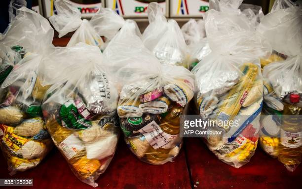 Bags of basic foodstuff are pictured inside one of the food distribution centers called CLAP which are run by community leaders in a neighbourhood of...
