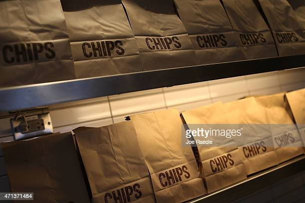 Bags of chips are seen ready for customers in a Chipotle restaurant on the day that the company announced it will only use nonGMO ingredients in its...