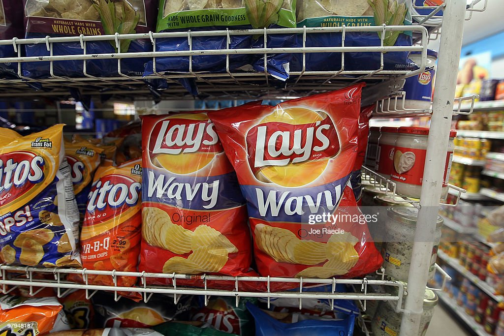 Bags of chips manufactured by PepsiCo Frito-Lay brand are seen on a shelf on March 22, 2010 in Miami, Florida. PepsiCo announced plans to cut sugar, fat, and sodium in its products to address health and nutrition concerns. The maker of soft drinks including Pepsi-Cola, Gatorade also makes Frito-Lay brand snacks.