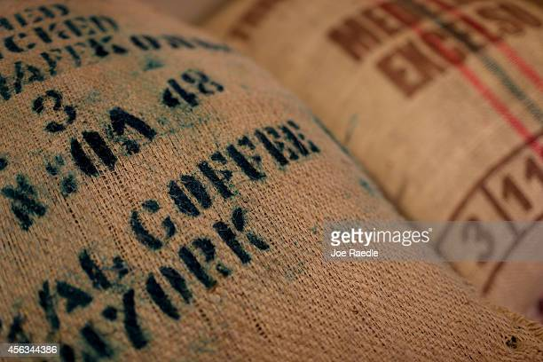 Bags of coffee beans are seen at Eternity Coffee Roasters during National Coffee Day on September 29 2014 in Miami Florida The day is for coffee...