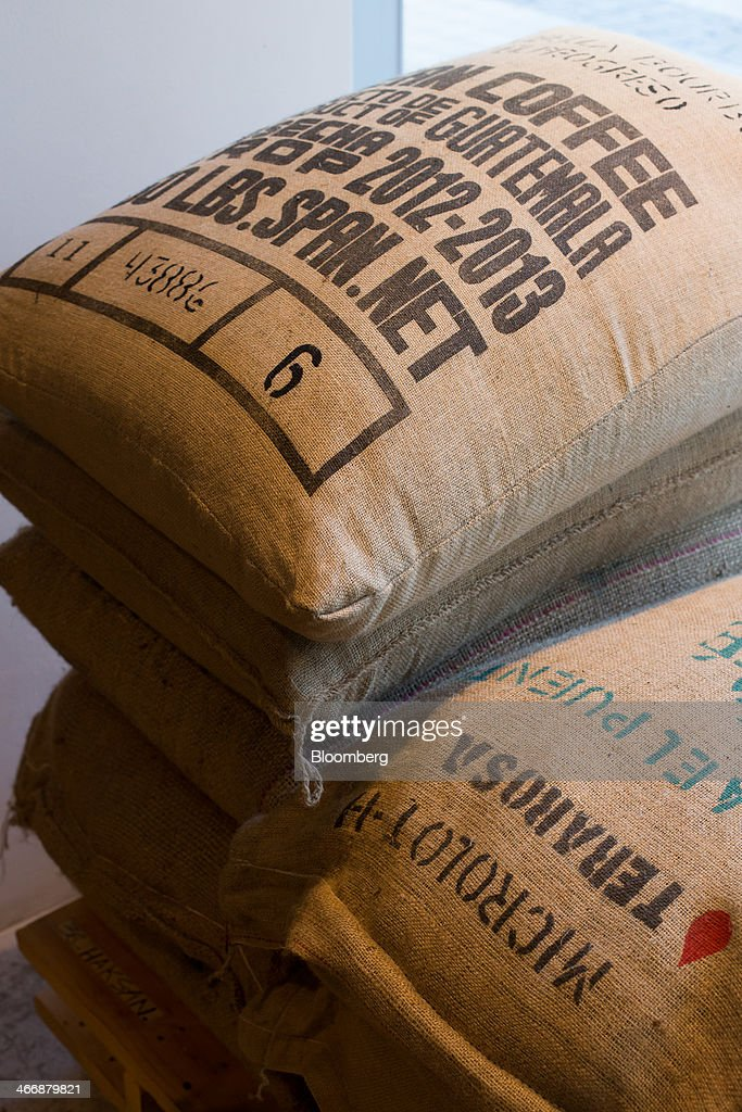 Bags of coffee beans are stacked at the Terarosa Coffee shop in Seoul, South Korea, on Tuesday, Feb. 4, 2014. South Korea is Asias fastest-growing market for arabica coffee, the mild-tasting beans used in premium blends. Photographer: SeongJoon Cho/Bloomberg via Getty Images