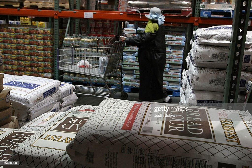 Bags of flour are displayed at a Costco store April 23 2008 in San Francisco California A worldwide shortage of flour has prompted US bigbox...