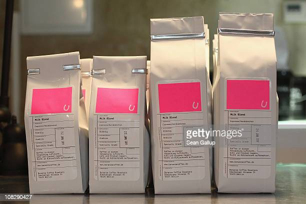 Bags of freshlyroasted espresso coffee stand on a counter for sale at Bonanza Coffee Roasters on January 24 2011 in Berlin Germany Bonanza founder...