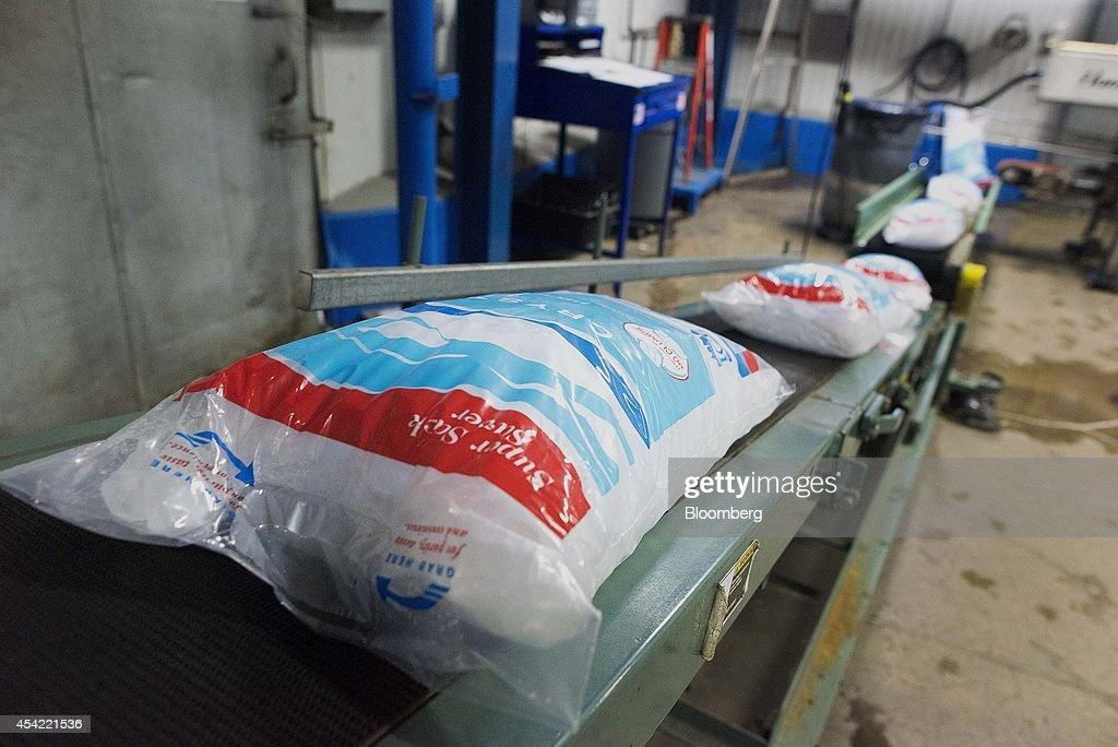 Bags of ice move along a conveyor belt at the Capital City Ice facility in Columbus, Ohio, U.S., on Tuesday, Aug, 26, 2014. The Institute for Supply Management (ISM) is scheduled to release U.S. manufacturing figures on Sept. 2. Photographer: Ty Wright/Bloomberg via Getty Images