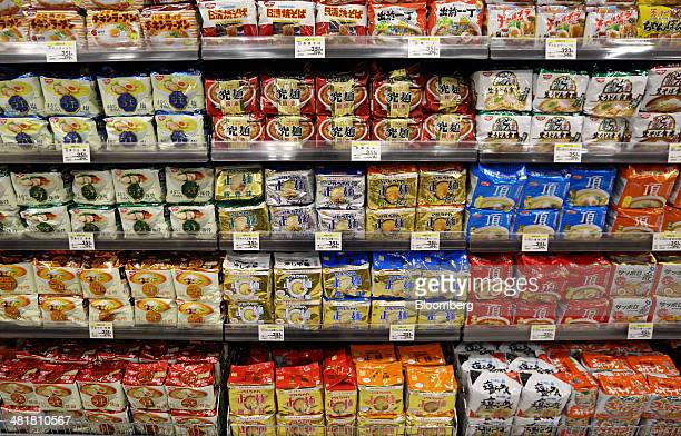 Bags of instant noodles are displayed for sale at an Aeon Co supermarket in Chiba Japan on Tuesday April 1 2014 Japan's economy will probably...