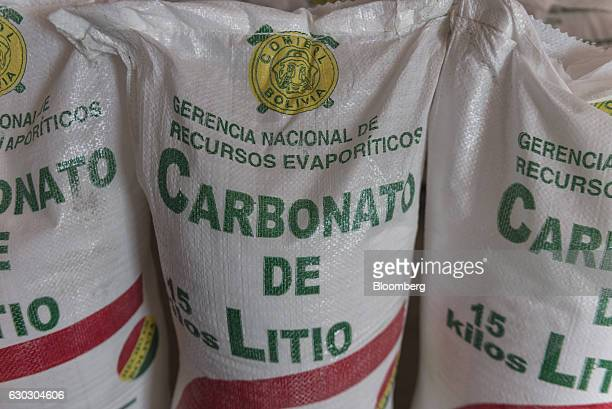 Bags of lithium carbonate stand inside the Llipi Pilot Plant at the entrance of the Salar de Uyuni in Potosi Bolivia on Saturday Dec 10 2016 Bolivia...