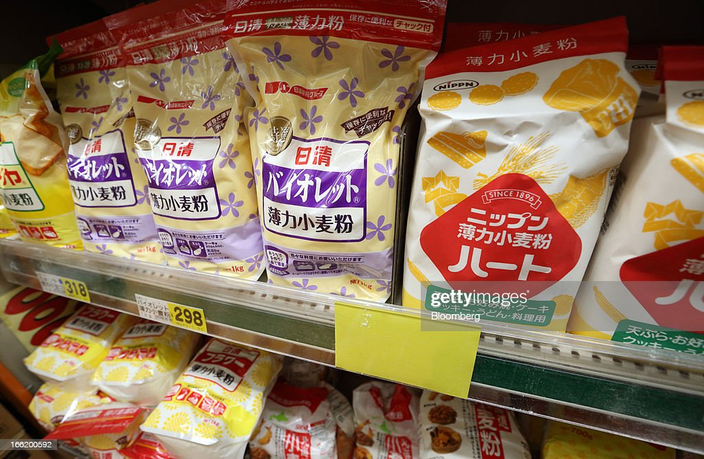 Bags of Nisshin Seifun Group Inc., left, and Nippon Flour Mills Co. wheat sit on a shelf for sale at a supermarket in Tokyo, Japan, on Tuesday, April 9, 2013. After Bank of Japan Governor Haruhiko Kuroda's first policy meeting as governor on April 4, the central bank set a two-year horizon for the 2 percent annual price-increase target that it adopted in January at the urging of Prime Minister Shinzo Abe. Photographer: Tomohiro Ohsumi/Bloomberg via Getty Images
