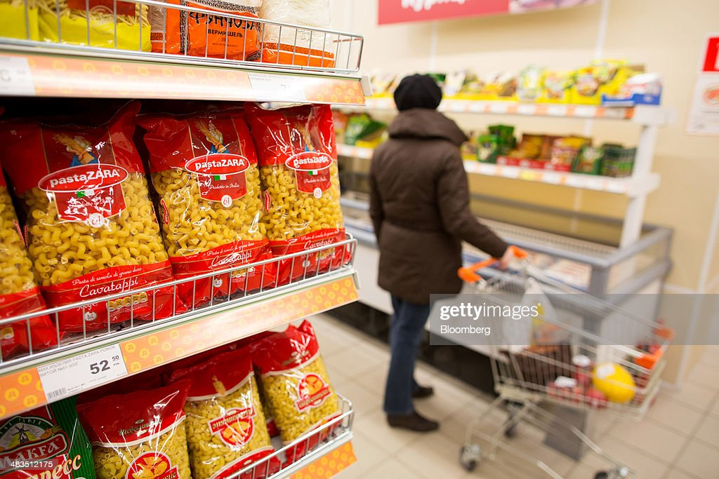 Bags of pasta, produced by Italian manufacturer Pasta Zara SpA, sit for sale inside a Dixy supermarket operated by OAO Dixy Group in Moscow, Russia, on Tuesday, April 8, 2014. Suppliers suffering from ruble depreciation this quarter are urging retailers to increase prices. Photographer: Andrey Rudakov/Bloomberg via Getty Images