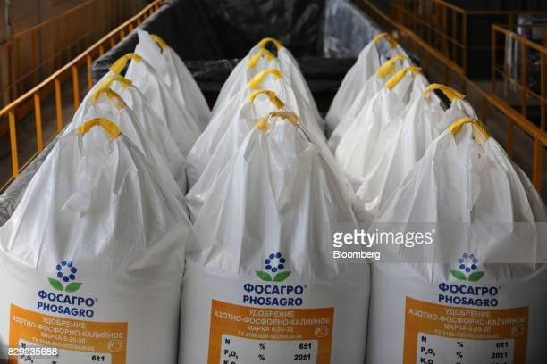 Bags of phosphate plant fertilizer are loaded onto a railway freight wagon at the PhosAgroCherepovets fertilizer plant operated by PhosAgro PJSC in...