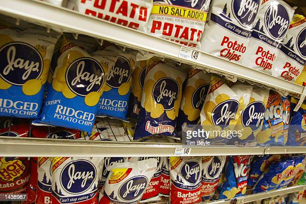 Bags of potato chips are seen on a grocery store shelf September 30 2002 in Chicago Illinois Scientists have made progress in understanding the...