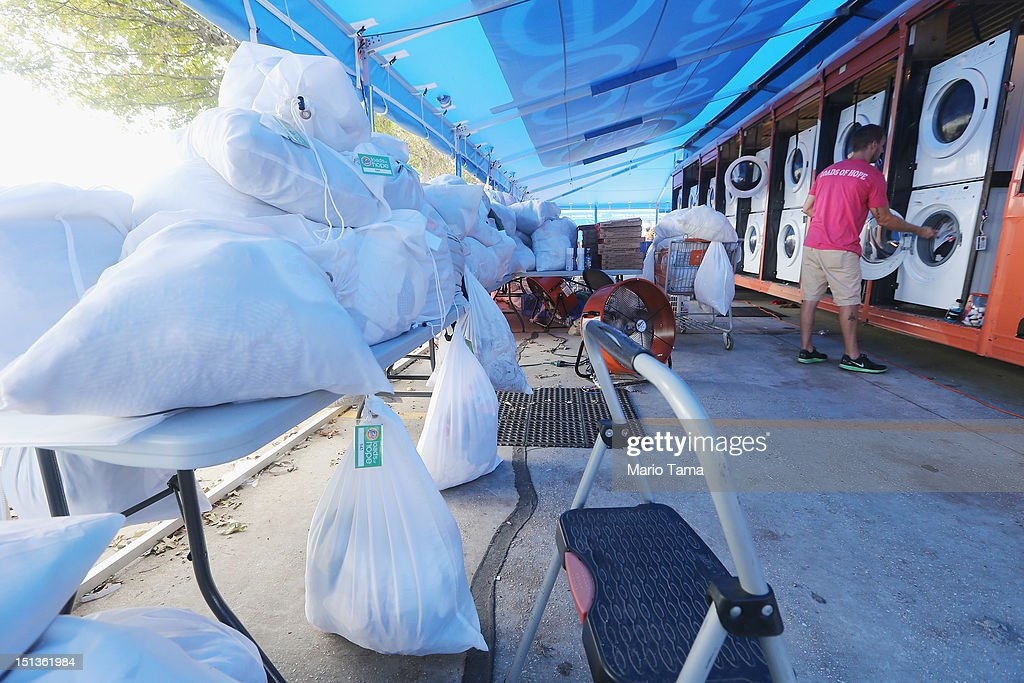 Bags of residents laundry wait to be washed for free at the Tide Loads of Hope mobile laundromat set up for those affected by Hurricane Isaac on September 6, 2012 in LaPlace, Louisiana. Louisiana officials estimate that at least 13,000 homes were damaged by Hurricane Isaac.