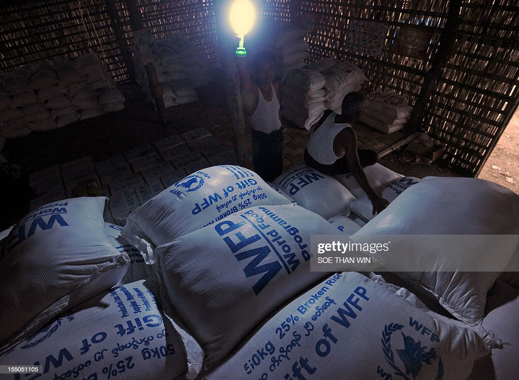 Bags of rice from the World Food Programme are pictured at the Ywagyi north relief camp in Sittwe, capital of Myanmar's western Rakhine state, on October 31, 2012. Food, water and medical help are in short supply at camps in western Myanmar that are 'stretched beyond capacity', a UN agency said, as authorities struggled to stem communal clashes. AFP PHOTO / Soe Than WIN