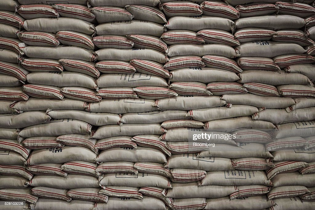 Bags of rice sit stacked at a National Food Authority warehouse in Quezon City Metro Manila the Philippines on Tuesday May 3 2016 Rice damage in the...