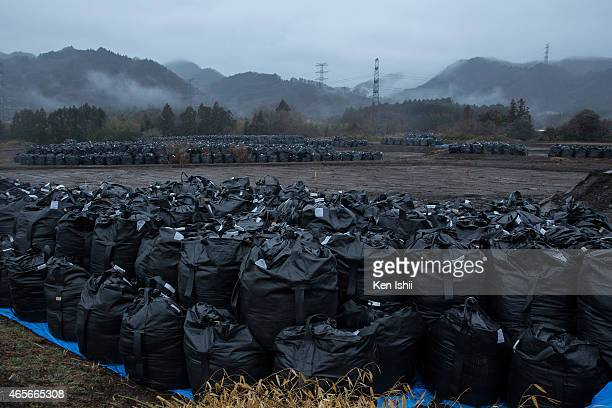 Bags of soil contaminated with radiation are stacked on March 9 2015 in Tomioka town Fukushima prefecture Japan On March 11 Japan commemorates the...