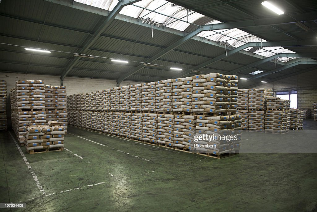 Bags of 'Spring' barley seed sit on pallets in a storage area at the Groupe Soufflet plant in Nogent-sur-Seine, France, on Tuesday, Dec. 4, 2012. European Union corn imports may be the second-highest on record this season after drought parched crops and a surge in wheat exports curbed domestic grain supply. Photographer: Balint Porneczi/Bloomberg via Getty Images