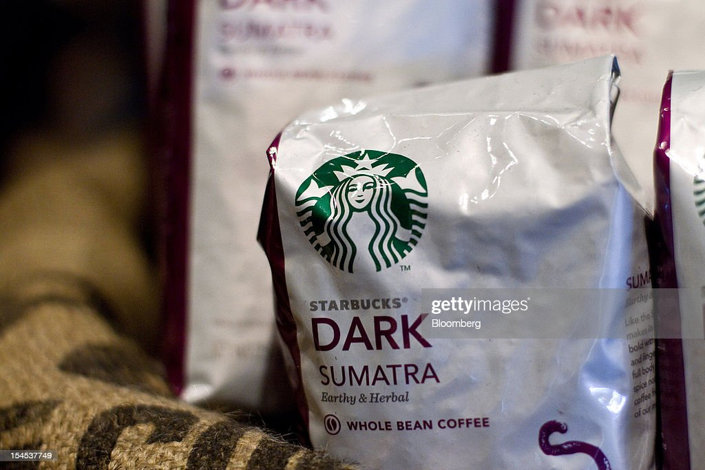 Bags of Starbucks Corp. Dark Sumatra coffee beans are displayed in the company's first India outlet in Mumbai, India, on Friday, Oct. 19, 2012. Starbucks, which opened its first store in India today, will maintain its partnership with Tata Global Beverages Ltd. and plans to take some of that company's products to new markets, Starbucks' Chief Executive Officer Howard Schultz said. Photographer: Dhiraj Singh/Bloomberg via Getty Images
