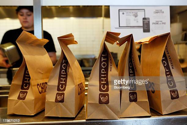 Bags of tortilla chips sit in a row at a Chipotle Mexican Grill Inc restaurant in Hollywood California US on Tuesday July 16 2013 Chipotle Mexican...