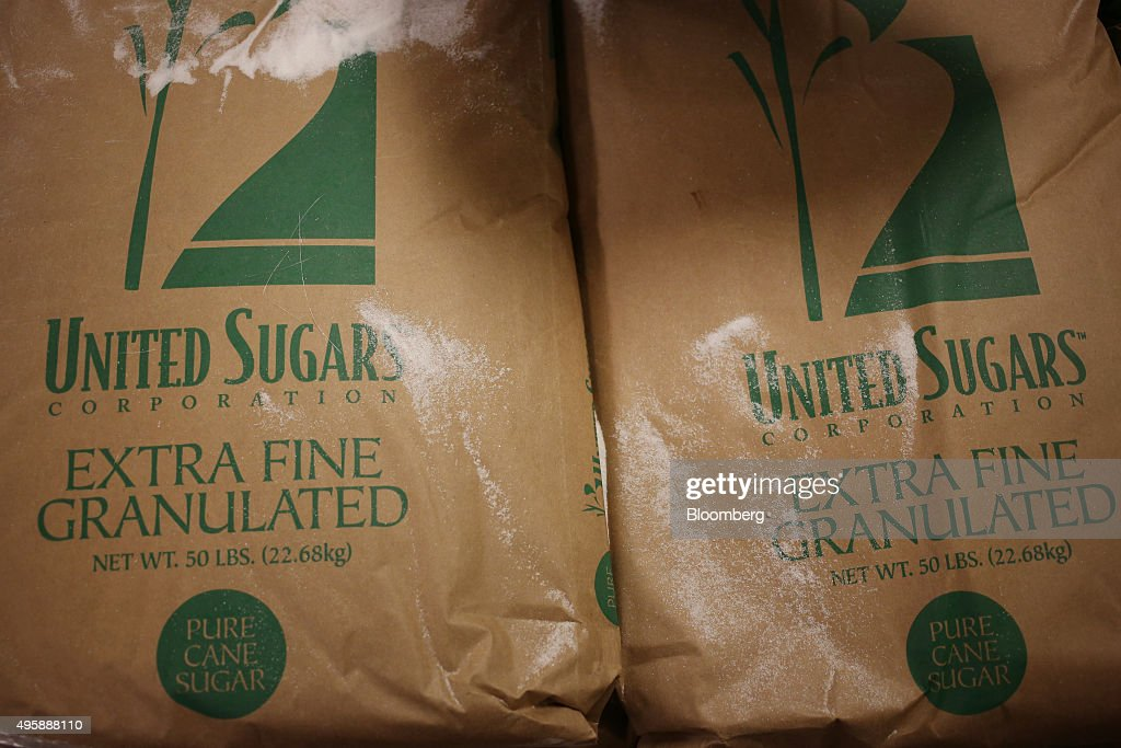Bags of United Sugars Corp pure cane sugar are seen before being added into a corn syrup candy cane mixture at the Hammond's Candies production...