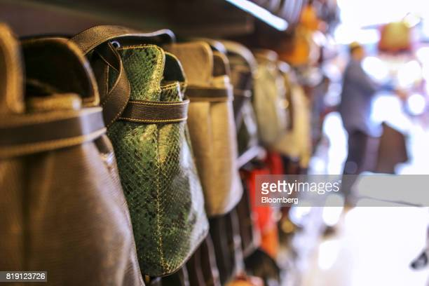 Bags sit on display at a leather goods store in the Dharavi area of Mumbai India on Tuesday July 18 2017 India's new goods and services tax...