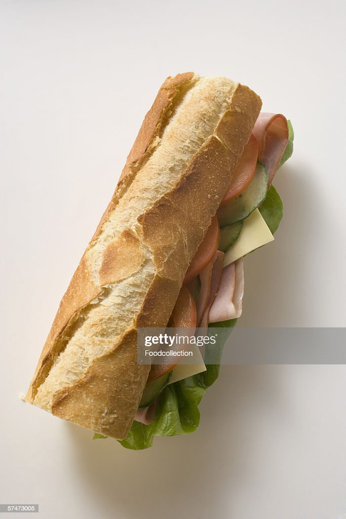 Baguette with ham, cheese, tomato, cucumber and lettuce