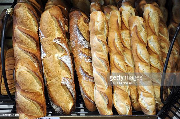 Baguettes and breads are on display in a bakery of Quimper on May 11 western of France AFP PHOTO FRED TANNEAU