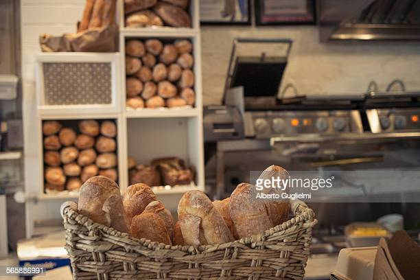 Baguettes in basket on bakery counter