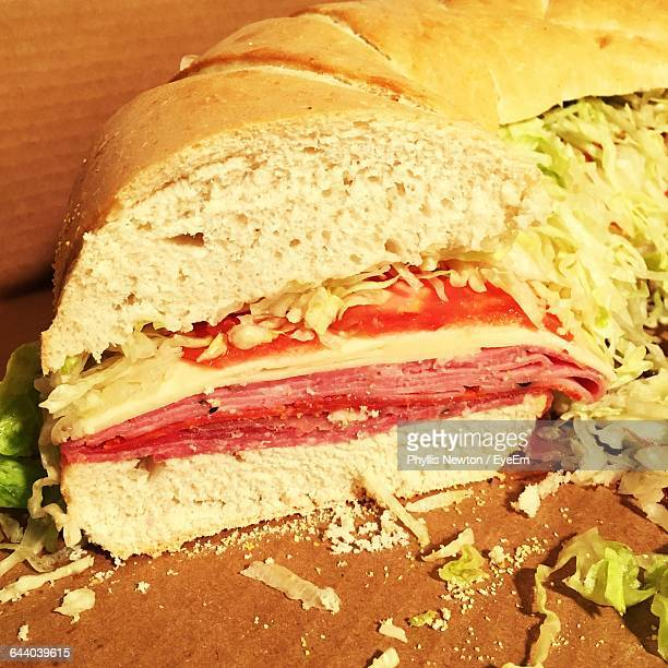 Baguettes Sliced Stuffed With Cheese, Ham, Salami And Vegetable Salad