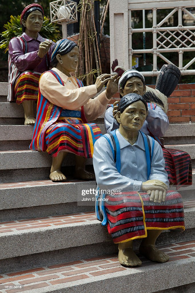BAGUIO, BENGUET, PHILIPPINES - : Baguio's Igorot Stairs are found right outside Barrio Fiesta, a famous restaurat specializing in local foods. The statues are mad of wood, even though they don't look like it as they have been painted over and varnished into a shiny platic-like sheen. The statues and wood sculptures depict the life of the Igorot tribe, the native inhabitants of Baguio. Today not all of the sculpture on the steps are those of Igorots - there are also those of famous Philippine political figures, such as past presidents, there are also sculpture of sleeping guards and some animals. The balance found in the sculptures can be seen obviously in the way that each sculpture has complete body parts. .