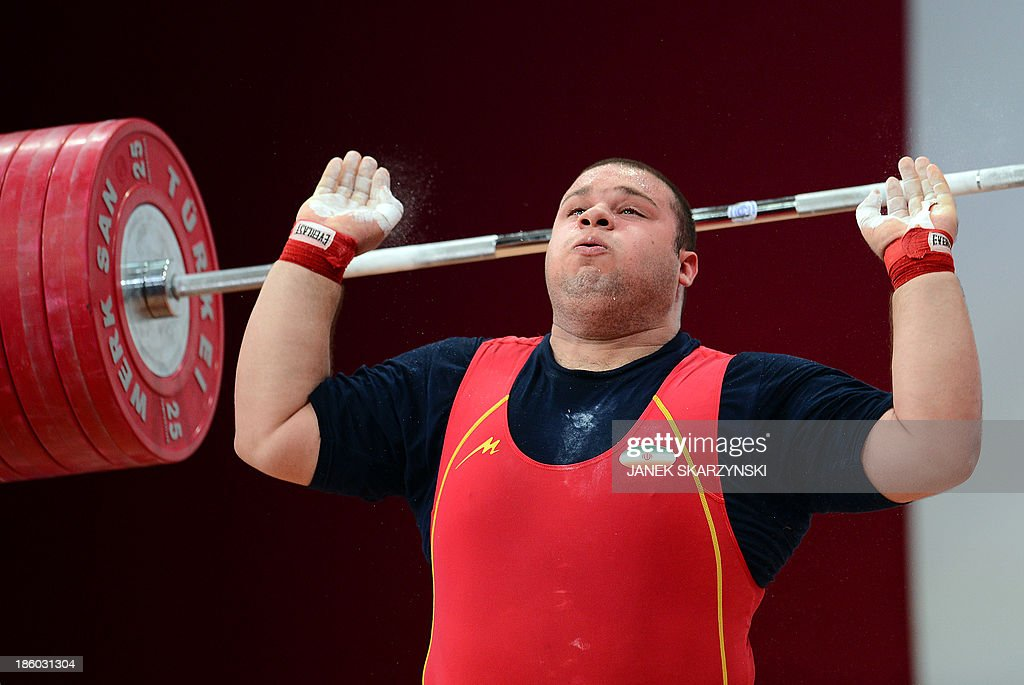 Bahador Moulaei of Iran competes in the men's +105 kg weightlifting IWF World Championships at Centennial Hall in Wroclaw, Poland on October 27, 2013. Bahador Moulaei won the silver medal in the competition.