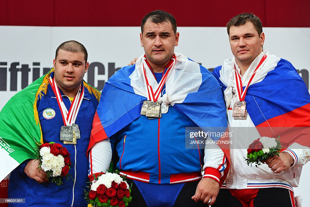 Bahador Moulaei of Iran, silver medal, Ruslan Albegov of Russia, gold medal and Aleksei Lovchev of Russia, bronze medal pose on the podium after the men's +105 kg weightlifting IWF World Championships at Centennial Hall in Wroclaw, Poland on October 27, 2013..