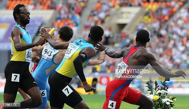 Bahamas' LaToy Williams hands over to Bahamas' O'Jay Ferguson during the men's 4x400 metres relay at the 2013 IAAF World Championships at the...