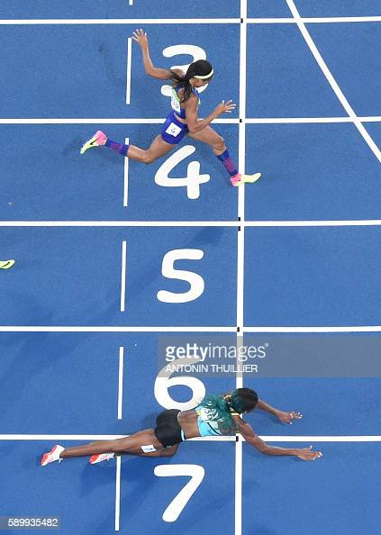 TOPSHOT CORRECTION Bahamas' Shaunae Miller dives to cross the finish line ahead of USA's Chase Kalisz during the Women's 400m Final during the...