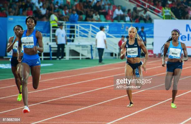 Bahamas' Shaunae MillerUibo runs to win the 400m race as Natasha Hastings and Quanera Hayes of the US take second and third place at the IAAF Diamond...