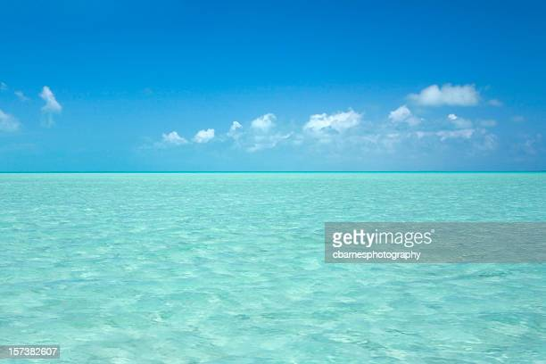 Bahamas turquoise blue shallow ocean water extend to horizon