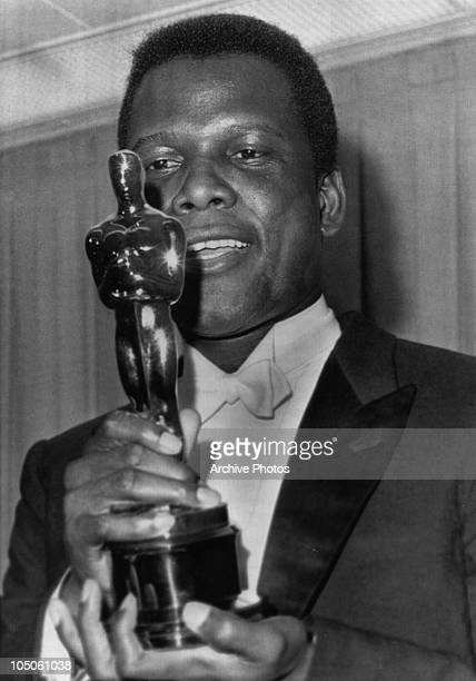Bahamian American actor Sidney Poitier holding his Academy Award for Best Actor in a Leading Role for 'Lilies Of The Field' directed by Ralph Nelson...