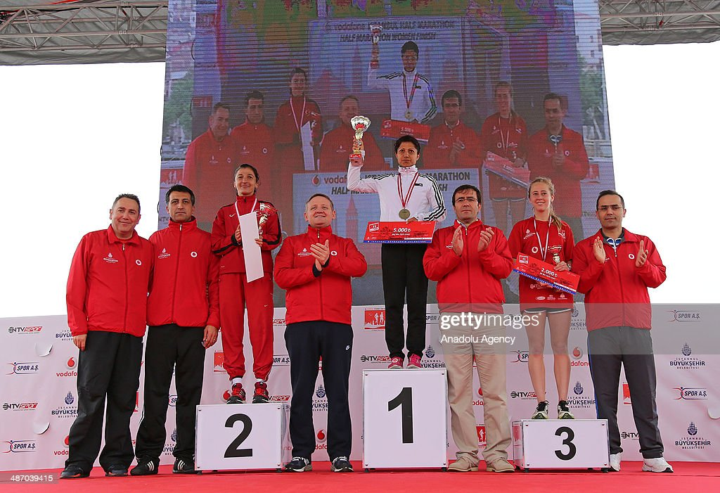 Bahar Dogan (winner, 4th R), 2nd placed Mehtap Sizmaz (3rd L) and 3rd placed Berger Stephane Lynn (2nd R) pose with their trophies during an award ceremony for Women's Division of the Vodafone Istanbul Half Marathon on April 27, 2014 in Istanbul, Turkey. The 21.1-kilometer race organized by Istanbul Metropolitan Municipality, began at the Old Galata Bridge in Balat, make a turn at Eyüp Hospital toward Kumkapi Fish Market and end in Balat at the same place it started.