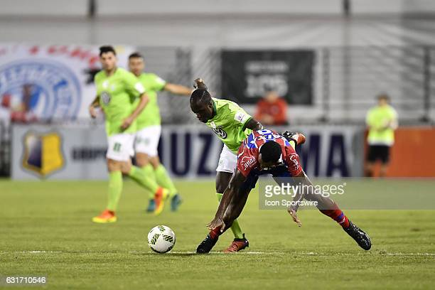 Bahia midfielder Rene Junior is fouled by Vfl Wolfsburg midfielder Amara Conde during the first half of the Florida Cup game between VfL Wolfsburg...