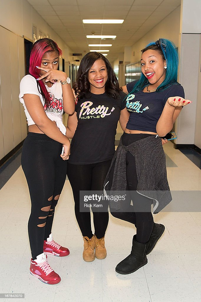 Bahja Rodriguez aka Miss Beauty, Breaunna Womack aka Miss Babydoll, and Zonnique Pullins aka Miss Star of the OMG Girlz pose during their Get Schooled Victory Tour at Stony Point High School on April 30, 2013 in Round Rock, Texas.