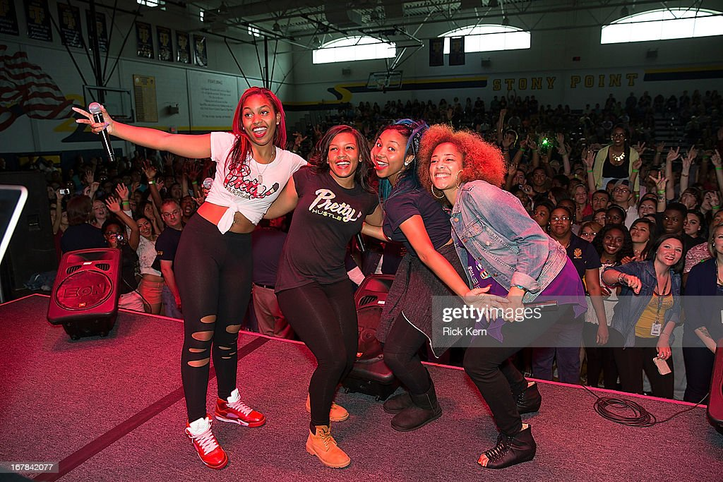 Bahja Rodriguez aka Miss Beauty, Breaunna Womack aka Miss Babydoll, Zonnique Pullins aka Miss Star of the OMG Girlz, and host Amanda Seales pose during the Get Schooled Victory Tour at Stony Point High School on April 30, 2013 in Round Rock, Texas.