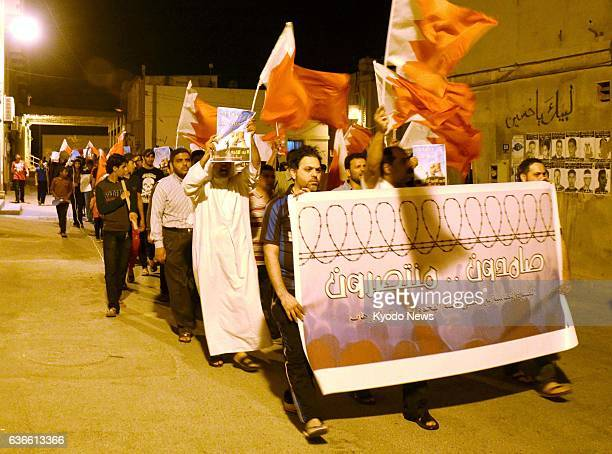 MANAMA Bahrain Antigovernment protesters march in Sitra near the Bahrain capital of Manama on March 25 2014