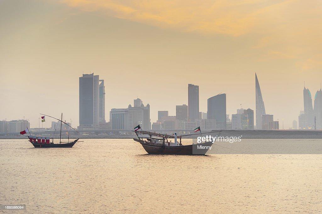 Bahrain Manama Skyline and Dhows at Sunset : Stock Photo