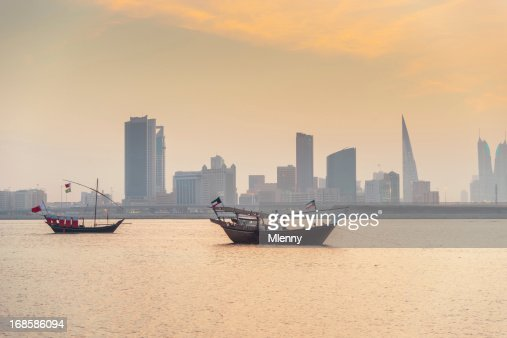 Bahrain Manama Skyline and Dhows at Sunset : Stock Photo