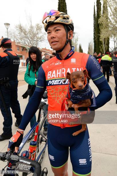 Bahrain Merida's Japanese rider Yukiya Arashiro holds his dog before the start of the fifth stage of the 97th Volta Catalunya 2017 a 182km from Valls...