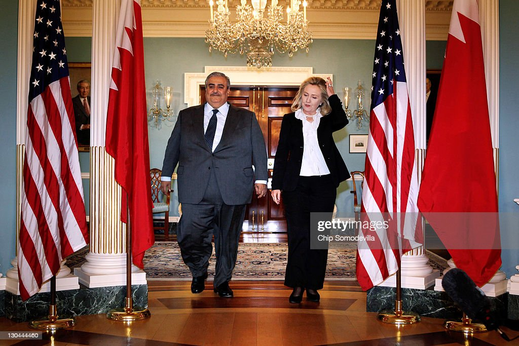 Bahraini Foreign Minister Shaikh Khalid bin Ahmed al-Khalifa (L) and U.S. Secretary of State <a gi-track='captionPersonalityLinkClicked' href=/galleries/search?phrase=Hillary+Clinton&family=editorial&specificpeople=76480 ng-click='$event.stopPropagation()'>Hillary Clinton</a> arrive for a media availability in the Treaty Room before bilaterial meetings at the Department of State October 26, 2011 in Washington, DC. Earlier this year, the Bahrain monarchy of King Hamad violently put down pro-democracy demonstrations inspired by the Arab Spring, a revolutionary wave of protests in the Middle East and North Africa.