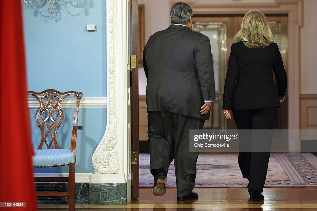 Bahraini Foreign Minister Shaikh Khalid bin Ahmed al-Khalifa (L) and U.S. Secretary of State <a gi-track='captionPersonalityLinkClicked' href=/galleries/search?phrase=Hillary+Clinton&family=editorial&specificpeople=76480 ng-click='$event.stopPropagation()'>Hillary Clinton</a> leave after a media availability in the Treaty Room before bilaterial meetings at the Department of State October 26, 2011 in Washington, DC. Earlier this year, the Bahrain monarchy of King Hamad violently put down pro-democracy demonstrations inspired by the Arab Spring, a revolutionary wave of protests in the Middle East and North Africa.