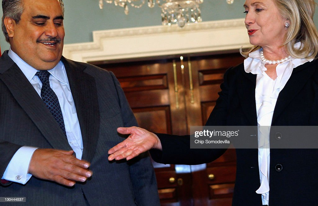 Bahraini Foreign Minister Shaikh Khalid bin Ahmed al-Khalifa (L) reaches out to shake hands with U.S. Secretary of State <a gi-track='captionPersonalityLinkClicked' href=/galleries/search?phrase=Hillary+Clinton&family=editorial&specificpeople=76480 ng-click='$event.stopPropagation()'>Hillary Clinton</a> in the Treaty Room before bilaterial meetings at the Department of State October 26, 2011 in Washington, DC. Earlier this year, the Bahrain monarchy of King Hamad violently put down pro-democracy demonstrations inspired by the Arab Spring, a revolutionary wave of protests in the Middle East and North Africa.