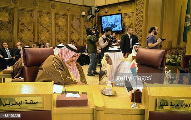 Bahraini Foreign Minister Sheikh Khaled bin Ahmed alKhalifa and UAE Minister of Sate for Foreign Affairs Anwar Mohammed Gargash attend the Arab...